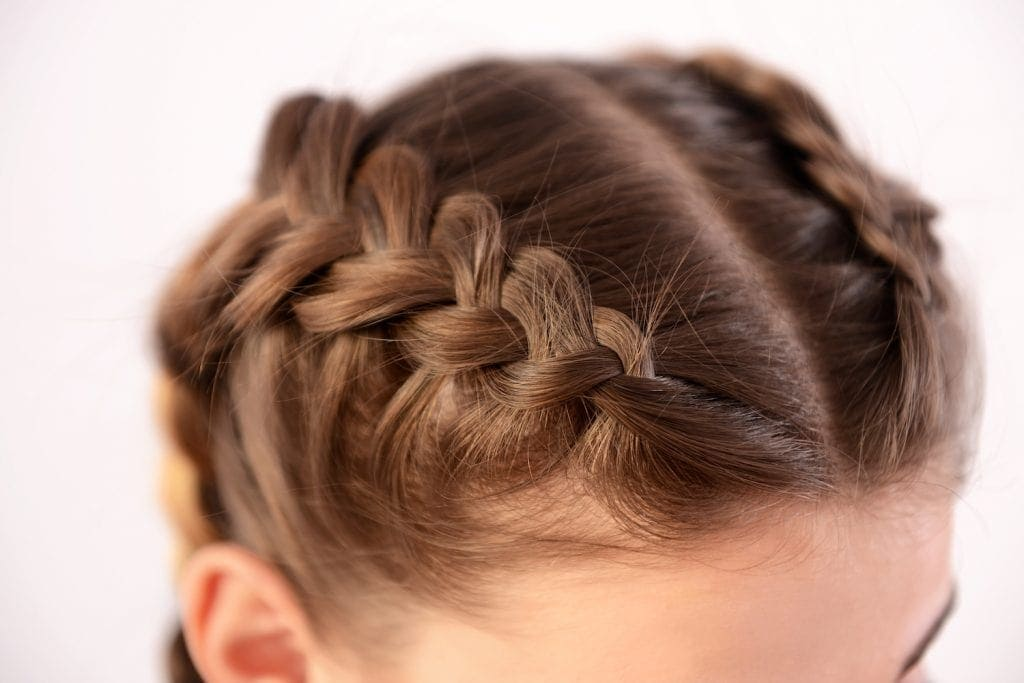example of protective hairstyle dutch braid